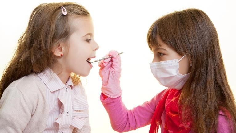 Two young girls playing with dental tools | Dentist Charlotte NC