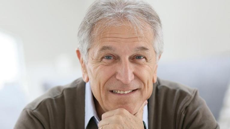 man smiling with dental implants in charlotte nc