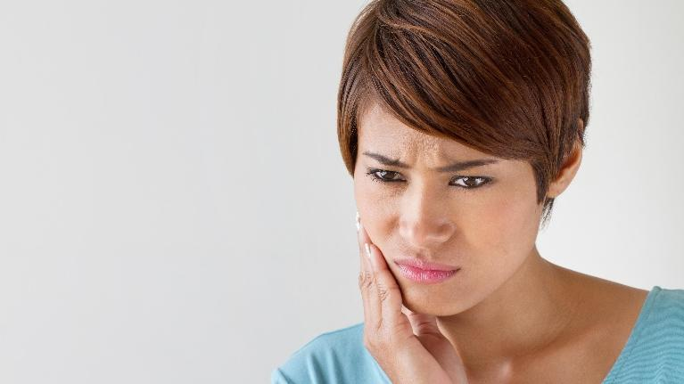 Dental Crowns in Charlotte NC | Woman in Oral Pain
